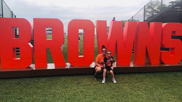 Photo of Ms. Stanley and her son at Brown's Training Camp.